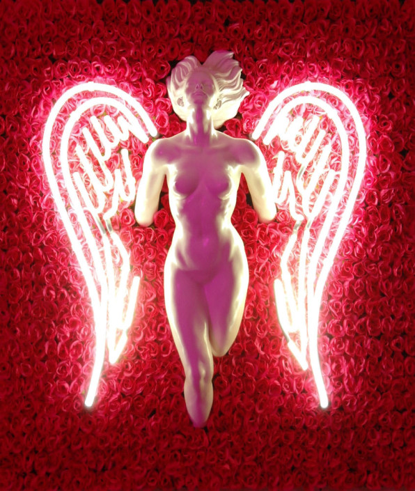 Darren West, Neon Angel, 2015. Neon glass, mixed media, roses, 30× 26 in or 76 × 66 cm.