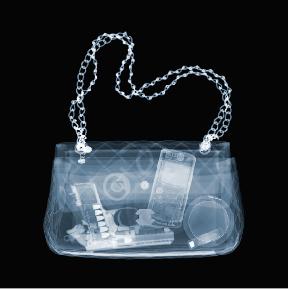 Nick Veasey, Chanel Packing Heat, 2015. C-Type Print Mounted on Plexi, Edition 9 47 × 47 in or 119.38 × 119.38 cm. Edition 25 23 × 23 in or 58.42 × 58.42 cm.