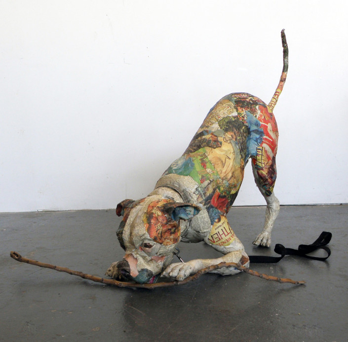 Will Kurtz, Artie and His Stick, 2016. Wood, wire, tape, glue, newspaper, UV matte varnish and wood stick. Unique work 22 x 12 x 48 in or 56 x 30.5 x 122 cm.