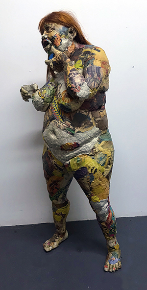 Will Kurtz, Adorra, 2011. Newspaper, wood, tape, glue, matte medium, UV matte varnish, wire, jewelry and cell phone. Unique work 32 x 30 x 66 in or 81 x 76 x 168 cm.