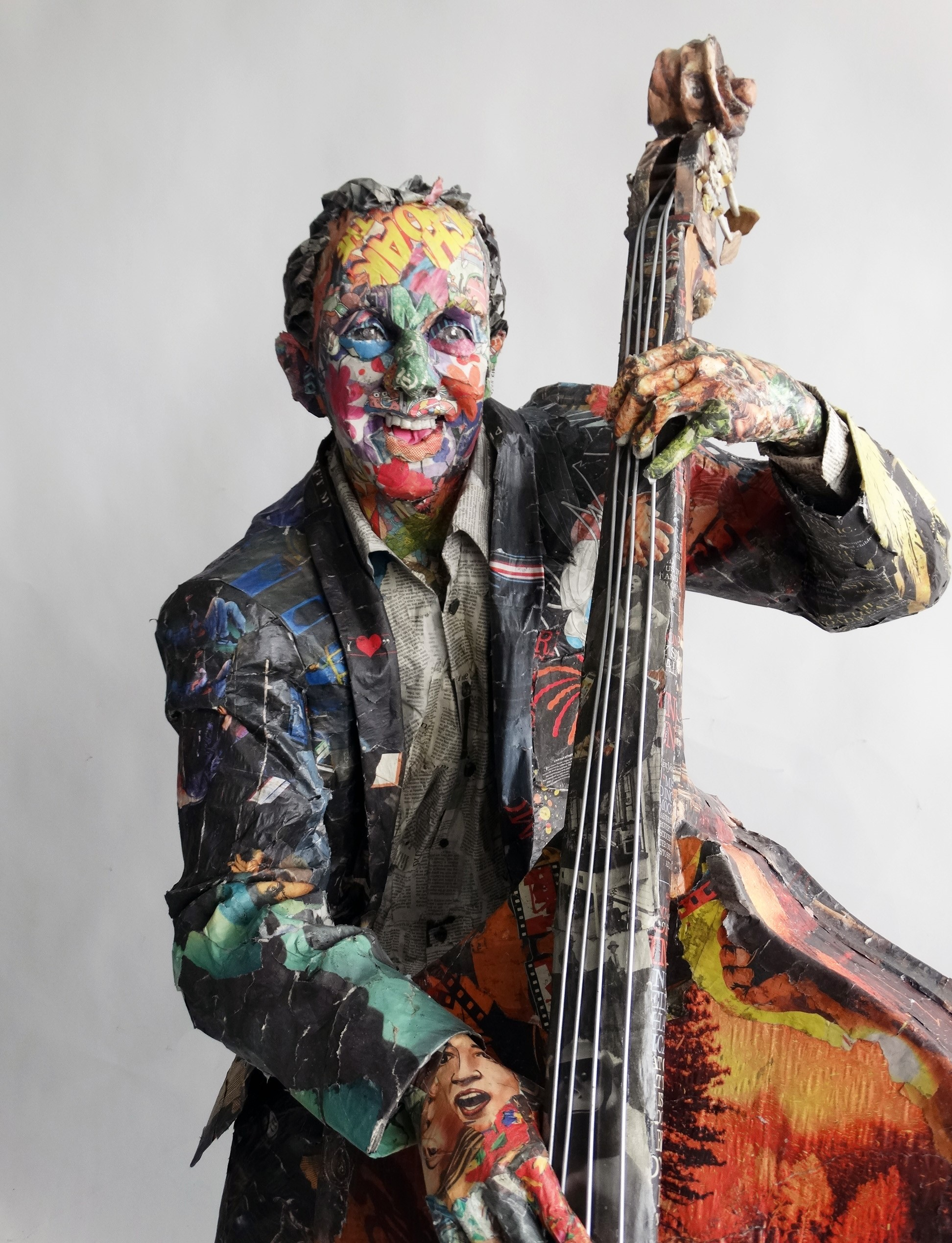 Will Kurtz, Bass Player, 2019. Wood, wire, cardboard, newspaper, tape, glue, matte medium, acid free spray, varnish. Unique work 74 x 44 x 40 in or 188 x 112 x 102 cm.